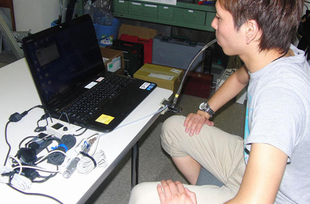 Kinki Univ. develops method to move computer mouse with breath (Source:The Asahi Shimbun)